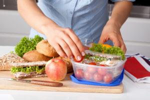 Sandwich being prepared on a cutting board