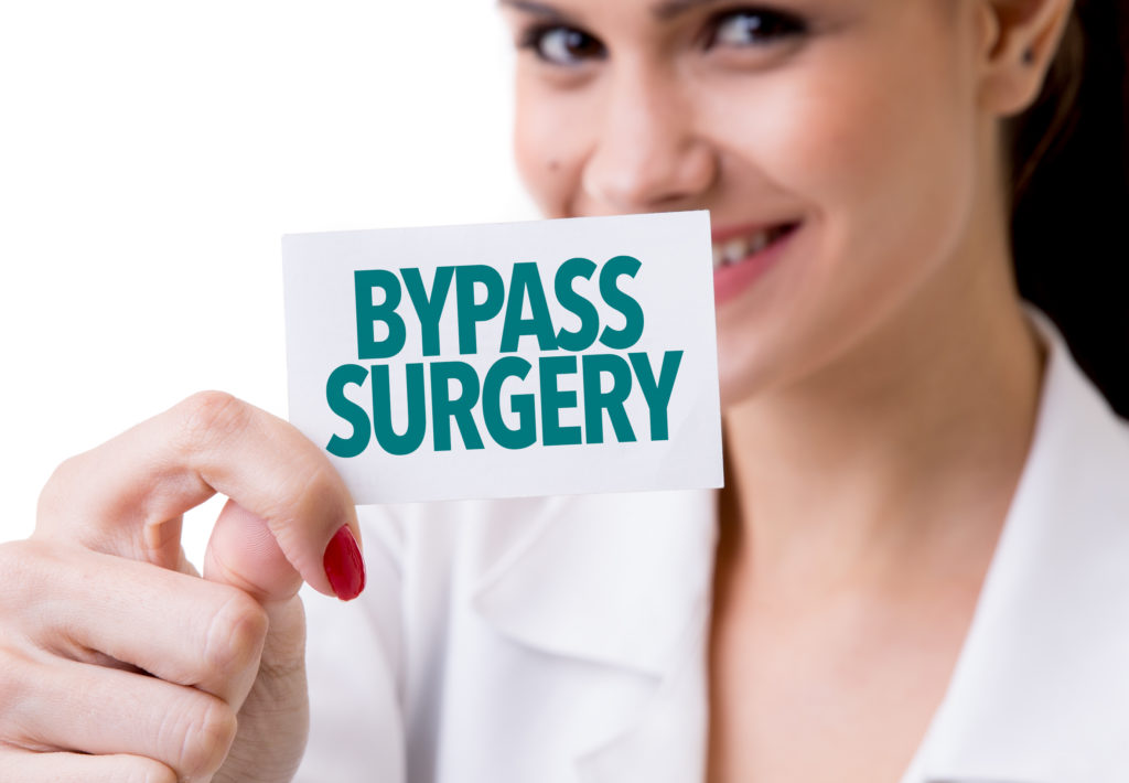 woman holding bypass surgery card
